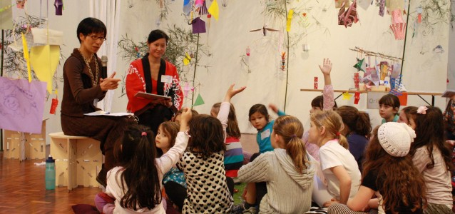 Artist Chaco Kato reads the Tanabata story to a group of children at Casula Powerhouse Arts Centre