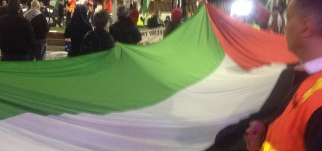 Protestors holding a Palestinian flag at Thursday's protest.