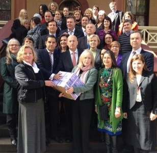 A petition with 14,000 signatures was presented to NSW Parliament. Photo: SOS Women's Services/Facebook