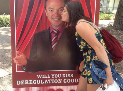 A student takes part in the PashPyne kissing booth. Source: Twitter.