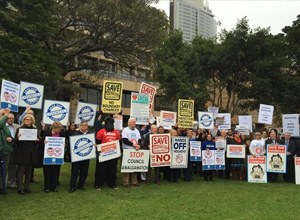Community protesters at a Save Our Council Coalition rally