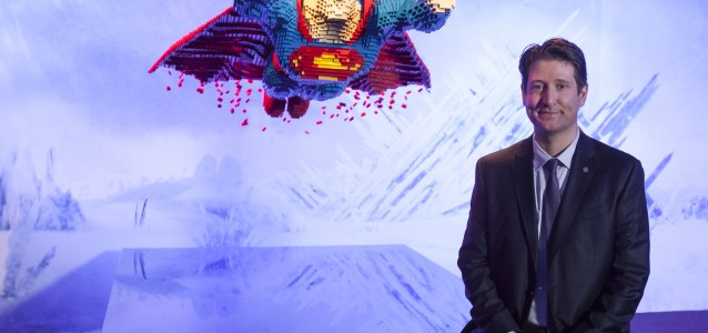 Artist Nathan Sawaya poses with his sculpture of Superman from THE ART OF THE BRICK: DC COMICS exhibition.